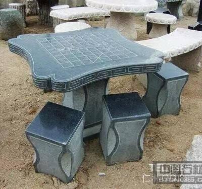 锈石异形石桌石凳雕刻